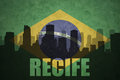 Abstract silhouette of the city with text Recife at the vintage brazilian flag