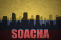 Abstract silhouette of the city with text Soacha at the vintage colombian flag