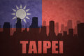 Abstract silhouette of the city with text Taipei at the vintage taiwan flag