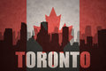 Abstract silhouette of the city with text Toronto at the vintage canadian flag Royalty Free Stock Photo