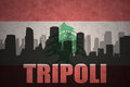 Abstract silhouette of the city with text Tripoli at the vintage lebanon flag Royalty Free Stock Photo