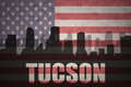 Abstract silhouette of the city with text Tucson at the vintage american flag
