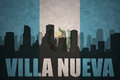 Abstract silhouette of the city with text Villa Nueva at the vintage guatemalan flag