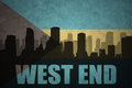 Abstract silhouette of the city with text West End at the vintage bahamas flag