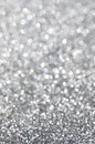 Abstract silver glitter holiday background unfocused Stock Image