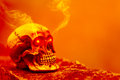 Abstract skull in orange tone with eye shining light and smoke. Royalty Free Stock Photo