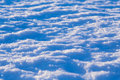 Abstract snow background at sunset lights
