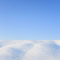 Abstract snow rolling hills landscape in winter tuscany italy abstrasct and blue clear sky background Royalty Free Stock Images