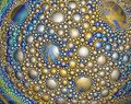Abstract spherical surface covered with colorful drops and bubbles.