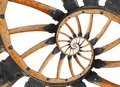Abstract spiral wooden wagon cannon wheel with black metal brackets, rivets. Wheel wooden spokes fractal background. Horse vehicle Royalty Free Stock Photo