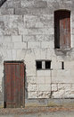 Abstract study of stonework and wooden doors. Royalty Free Stock Photo