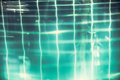 Abstract swimming pool background with transparent turquoise water and net pattern in vintage style Royalty Free Stock Photo