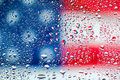 Abstract texture water drops on glass with usa flag background Stock Images