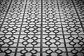 Abstract tile background in black and white square with geometric pattern simple flower on each one sidewalk paved with street Royalty Free Stock Photo