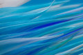 Abstract tubular tapering blue flames modern artistic glass like tubes to pointy tips structure looks like solid colors range from Stock Image