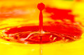 abstract wallpaper of a red liquid paint drop splashing Royalty Free Stock Photo