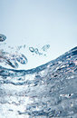 Abstract water background beauty of blue clear splashes freeze vertical photo Royalty Free Stock Images
