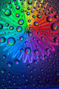 Abstract water drops on glass with different color backgrounds Stock Photos