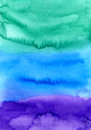Abstract watercolor hand painted background. Colorful texture in green, blue and purple colors. Royalty Free Stock Photo