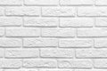 Abstract weathered texture stained old stucco light gray white brick wall background, grungy blocks of stonework Royalty Free Stock Photo