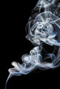 Abstract white blue smoke from aromatic sticks. Royalty Free Stock Photo