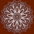 Abstract white pattern like as snowflake crocheting serviette red background Stock Photo