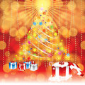 Abstract winter christmas background with gifts and tree in background Stock Photo