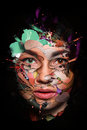 Woman face close up inside colorful paint in abstract shapes Royalty Free Stock Photo