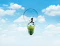Abstract women jump on green nature in bulb light with blue sky Royalty Free Stock Photo