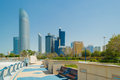 Abu dhabi corniche the garden the promenade skyline on the background Royalty Free Stock Image