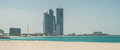 Abu dhabi skyline viewed from the corniche beach Royalty Free Stock Photos