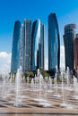 Abu dhabi view to the modern center of etihad towers fountains at foreground Stock Photos