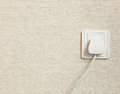 AC power plug in wall socket Royalty Free Stock Photo