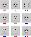 Ac power sockets various with the flags of countries that use Royalty Free Stock Images