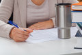 Academic teacher with coffee during writing an article a and books Royalty Free Stock Images