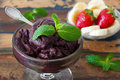 Acai pulp in glass with fresh mint, strawberry and  banana Royalty Free Stock Photo