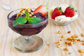 Acai pulp with strawberry banana muesli and fresh mint in glass selective focus Stock Photos