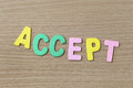 Accept of colorful text on a brown wood background Royalty Free Stock Photo