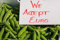 We accept euro a sign on top of box with green peas Stock Photography