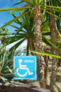 Accessibility sign for disabled leading to the beach exotic vegetation in the background costa del sol spain Royalty Free Stock Photography