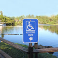 Accessible route sign a directional with handicapped logo shows for disable people who visiting the park Stock Photography