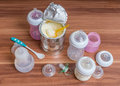 Accessories for feeding baby bottles teats and milk formula on wooden table Stock Photos
