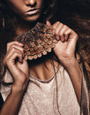 Accessory of pine cone in woman hands studio Stock Photo