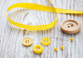 Accessory of the tailor sewing background in yellow colors Royalty Free Stock Photo