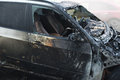 Accident or arson burnt car on the road closeup Royalty Free Stock Images