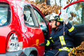 Accident, Fire brigade rescues Victim of a car Royalty Free Stock Photo
