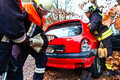 Accident fire brigade rescues victim of a car crash using hydraulic rescue tool Royalty Free Stock Images