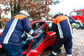 Accident fire brigade rescues victim of a car using hydraulic rescue tool Royalty Free Stock Photos