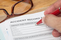 Accident report application form and human hand with pen Royalty Free Stock Photo