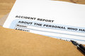 Accident report application form and pen on brown envelope, business insurance and risk concept; document is mock-up Royalty Free Stock Photo